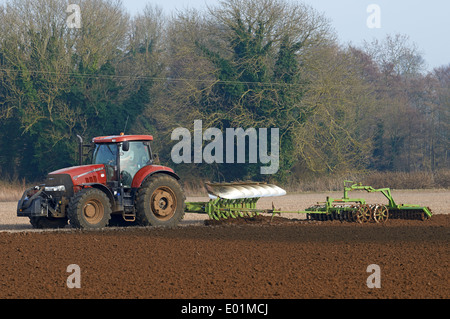 Tractor ploughing with a farrow press attachment - Stock Photo