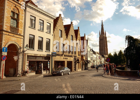 Traditional buildings, Gruuthsestraat along the Dijver Canal, with Church of our Lady in the background, Bruges, - Stock Photo