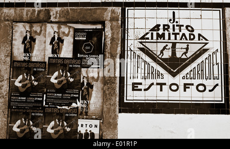 Entertainment concert adverts posters and tiled wall design in Bairro Alto district Lisbon Portugal Europe - Stock Photo