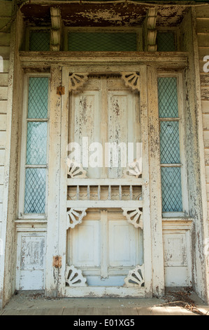 Front door of an old abandoned house in rural Virginia. - Stock Photo