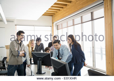 High school students and teacher in computer lab - Stock Photo