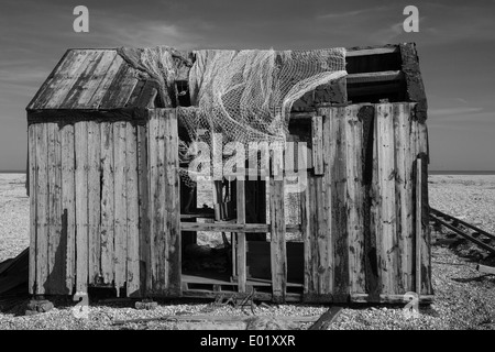Abandoned fisherman's hut on the beach at Dungeness Kent Spring 2014 - Stock Photo