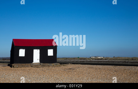 Small colourful hut creating a bright landmark at Rye Harbour East Sussex - Stock Photo