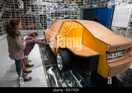 Visitors examine car design model at BMW Museum in Munich Germany - Stock Photo