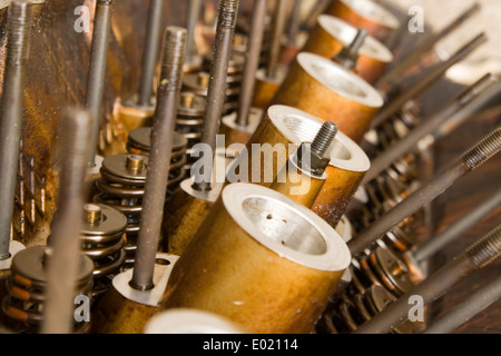 A close up of a head off a internal combustion engine including valve springs - Stock Photo