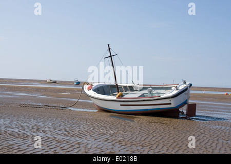 sail boat marooned on the beach - Stock Photo