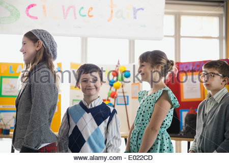 Portrait of smiling school boy at science fair - Stock Photo