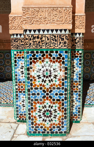 Berber arabesque Morcabe plasterwork and Zellige tiles of the 14th century Ben Youssef Madersa, Marrakesh, Morocco - Stock Photo