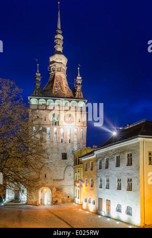 clock tower in historic center of sighisoara, transylvania, romania at night - Stock Photo