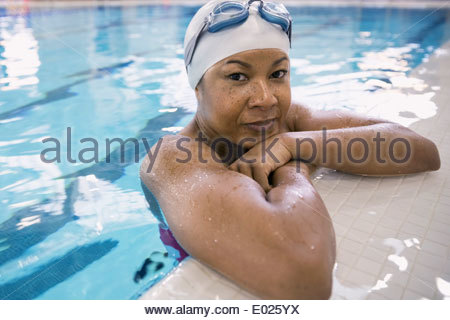 Close up portrait of woman in swimming pool - Stock Photo
