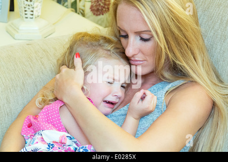 young mother comforting her daughter - Stock Photo
