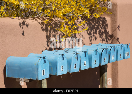 Row of blue mailboxes numbered 1 through 8 and 204. - Stock Photo