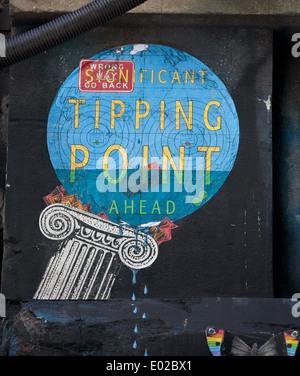 Tipping point street art in Hosier Lane, Melbourne - Stock Photo