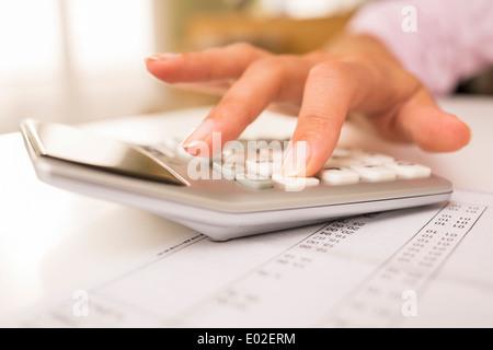 Female finger desk indoor white bill invoice - Stock Photo