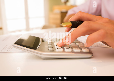 Female finger desk indoor white bill invoice - Stock Photo