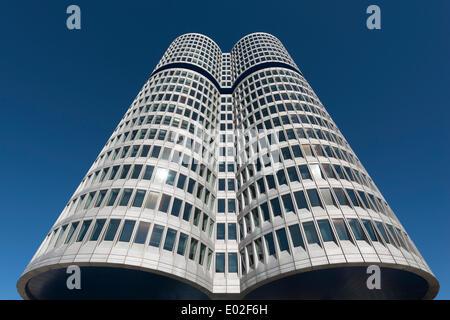 BMW Tower or BMW four-cylinder, corporate headquarters, Munich, Upper Bavaria, Bavaria, Germany - Stock Photo