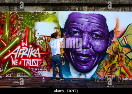 Graffiti artists standing in front of a graffiti of Nelson Mandela, bank of the Seine River, Paris, Île-de-France, - Stock Photo