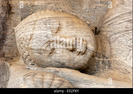 Head and face of a reclining Buddha statue, Sayana Mudra, rock relief, Gal Vihara Temple, Polonnaruwa, North Central - Stock Photo