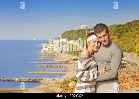 young couple on the background of beautiful scenery - Stock Photo