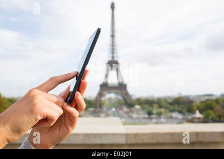 Close up of hands Female mobile phone Paris message sms e-mail - Stock Photo