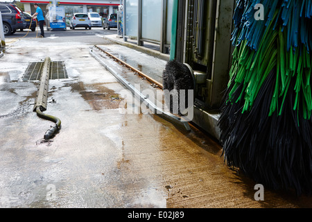 wheel scrub brush on automatic petrol filling station car wash northern ireland - Stock Photo