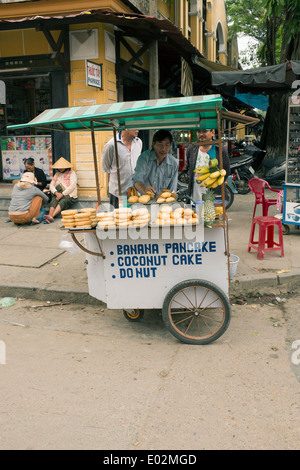 Fast Food Street Stall selling Pancakes Donuts in the Old Town Hoi An Vietnam - Stock Photo