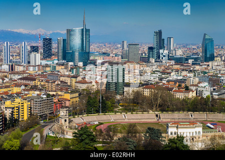 Porta Nuova financial district skyline with the Alps in the background, Milan, Lombardy, Italy - Stock Photo