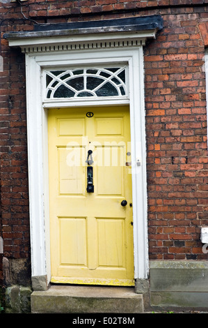 Yellow front door of house in Hereford Herefordshire England UK - Stock Photo
