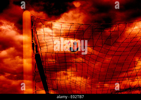 soccer ball in the net, goal scoring - Stock Photo