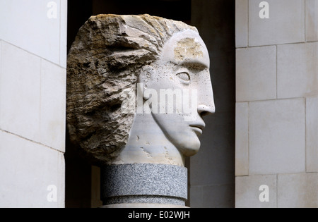 London, England, UK. Angel Head (one of five by Emily Young) by St Paul's Cathedral - Stock Photo