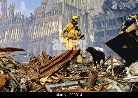 Urban Search and Rescue teams search for survivors amongst the wreckage of the World Trade Center following a massive - Stock Photo