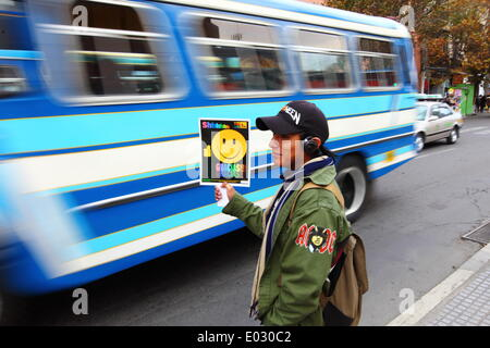 LA PAZ, BOLIVIA, 30th April 2014. A student with an AC/DC 'Highway to Hell' badge on his jacket holds a placard - Stock Photo