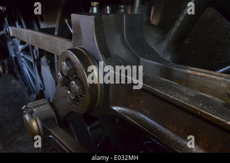 Steam train driving wheels and connecting rods. - Stock Photo