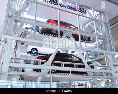 Several cars on elevator in a multi-level parking garage at Toyota Mega Web city showcase at Odaiba, Tokyo, Japan - Stock Photo