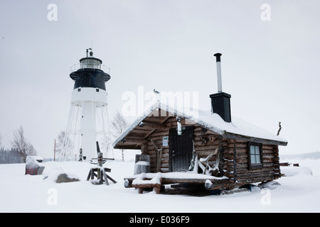 JAVRE, SWEDEN Lighthouse and cabin in winter. - Stock Photo