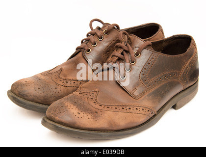 Old worn out brown shoes isolated on a white background - Stock Photo