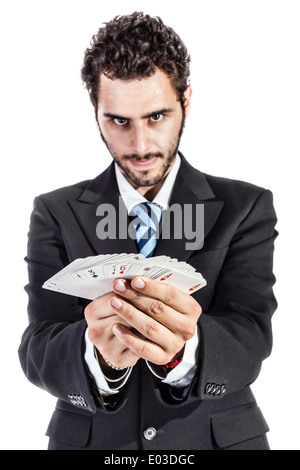 an elegant young businessman holding a deck of playing cards - Stock Photo
