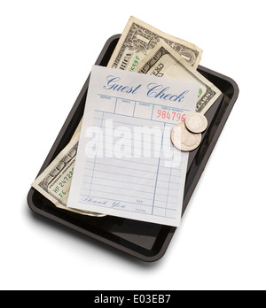 Restaurant bill with money on payment tray isolated on a white background. - Stock Photo