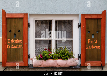 Window with shutters on traditional Estonian restaurant. - Stock Photo