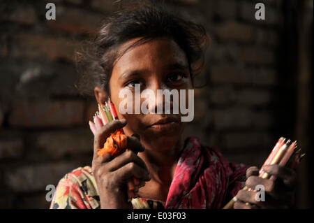 DHAKA, BANGLADESH - APRIL 30: According to the Labor Law of Bangladesh, the minimum legal age for employment is - Stock Photo