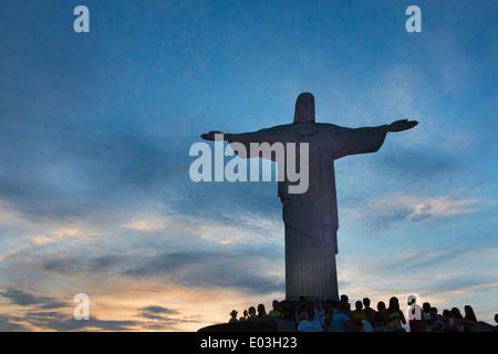 Tourists watching statue of Christ the Redeemer on Corcovado, Rio de Janeiro, Brazil - Stock Photo