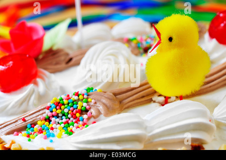 closeup of a mona de pascua, a cake eaten in Spain on Easter Monday, ornamented with a teddy chick - Stock Photo