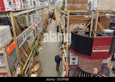 View down an aisle at Hone Depot store in Jericho, Long Island, New York - Stock Photo