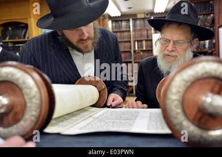 Torah reading during Passover morning prayers at a synagogue in Brooklyn, New York - Stock Photo