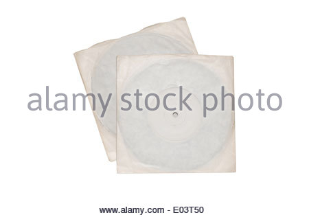 Two old vinyl single records discs in plain sleeves isolated on white background - Stock Photo