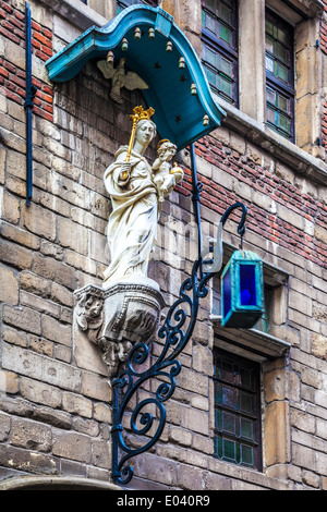 Statue of the Virgin and Child on an old building in Vleeshouwers Straat, Antwerp, Belgium. - Stock Photo