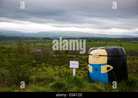 Wray, Lancaster, 1st May 2014.  'Despicable Me' dry hay bales wrapped in black plastic, with a sign 'Plaus 'able' - Stock Photo
