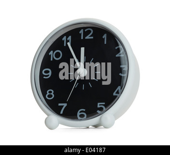 Black and White Clock almost at 12 O'clock. Isolated on White Background. - Stock Photo