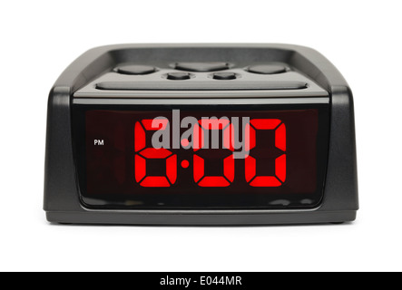 Black Plastic Alarm Clock With Red Display Isolated on White Background. - Stock Photo