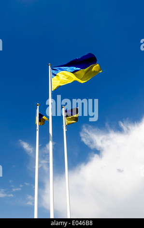 Flag of Ukraine against the background of blue sky - Stock Photo